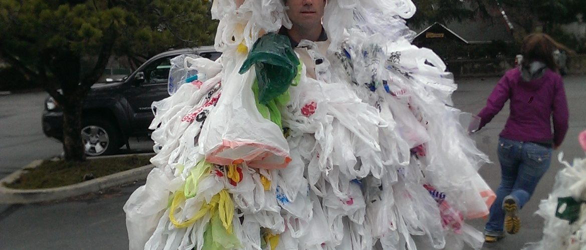 A man wearing a bag monster suit, made of 500 plastic bags